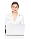 Woman sits from the table with laptop in white shirt beautiful smiling thу isolated on Stock Photo