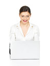 Woman sits from the table with laptop in white shirt beautiful smiling thу isolated on Royalty Free Stock Photo