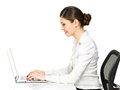 Woman sits from the table and working on laptop beautiful smiling in white shirt isolated white Stock Photos
