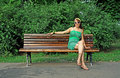 Woman sitting alone on bench Stock Image