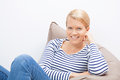 Woman sitting on a beanbag beautiful blond Royalty Free Stock Photography