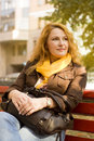 Woman sitting on bench resting after work Royalty Free Stock Photo