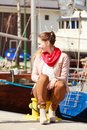 Woman sitting on bitt in marina Royalty Free Stock Photo