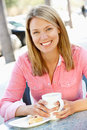 Woman sitting in cafe Royalty Free Stock Image