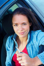 Woman sitting in a car and holding key Stock Photos