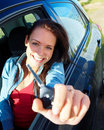 Woman sitting in a car and showing keys Royalty Free Stock Image