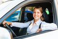 Woman sitting in the car and smiling Royalty Free Stock Images