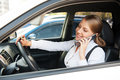 Woman sitting in the car and talking on the phone Royalty Free Stock Photography