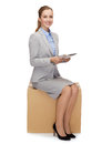 Woman sitting on cardboard box with tablet pc business and delivery service concept smiling computer Royalty Free Stock Photos