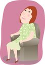 Woman sitting comfortably in a chair redheaded sits relaxing Royalty Free Stock Photography
