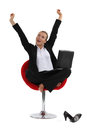 Woman sitting cross legged in a chair and stretching her arms Royalty Free Stock Images
