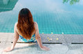 Woman sitting at the Edge of Swimming Pool Stock Images