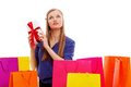 Woman sitting on the floor behind shopping bags Royalty Free Stock Photo