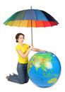Woman sitting and holding umbrella under big globe Royalty Free Stock Photos