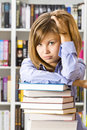Woman sitting in the library Stock Photography