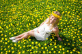 Woman sitting in the meadow Royalty Free Stock Photo