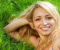 Woman sitting outdoors smiling Royalty Free Stock Photos