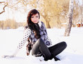 Woman sitting in the snow portrait of a a fur vest Stock Image