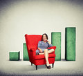 Woman sitting in soft red chair over rising chart background Royalty Free Stock Photo