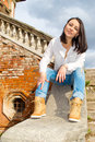 Woman sitting on stone staircase railing Royalty Free Stock Photo
