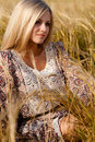 Woman sitting on wheat field Royalty Free Stock Photography