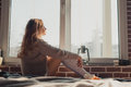 Woman sitting at the window Royalty Free Stock Photo