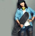 Woman with skateboard portrait of beautiful young Stock Image
