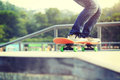 Woman skateboarders jumping on a skateboard park Stock Photography