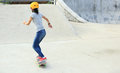 Woman skateboarders riding on a skateboard park Stock Images