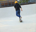 Woman skateboarders riding on a skateboard park Stock Photos