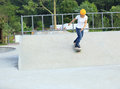 Woman skateboarders riding on a skateboard park Royalty Free Stock Photo