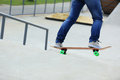 Woman skateboarders riding on a skateboard park Stock Photo