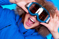 Woman in ski glasses and winter coat Royalty Free Stock Images