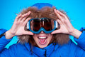 Woman in ski glasses and winter coat Royalty Free Stock Photo