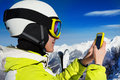 Woman in ski mask and helmet use cell phone Royalty Free Stock Photo