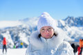 Woman in ski suit on a background of mountains Stock Photography