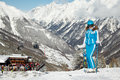Woman in ski suit and helmet poses Stock Photography