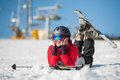 Woman skier with ski at winer resort in sunny day Royalty Free Stock Photo
