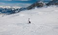 A woman is skiing at a ski resort of kaprun kitzsteinhorn glaci glacier austria Royalty Free Stock Photo