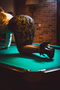 Woman in skirt and stockings kneeling on billiard Stock Photos