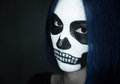 Woman with skull face art portrait of young make up halloween Stock Photo