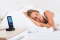 Woman Sleeping With Alarm On Mobile Phone Royalty Free Stock Photo