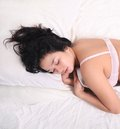 Woman sleeping on bed Stock Image
