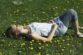 Woman sleeping on grass Stock Photo