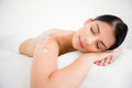 Woman sleeping with salt scrub on the back Royalty Free Stock Photo