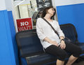 Woman sleeping waiting for appointment asleep on chair Royalty Free Stock Images