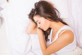 Woman sleeping in white bed, Royalty Free Stock Photo