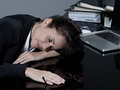 Woman sleeping at work beautiful brunette business her desk Stock Image