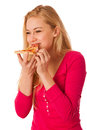 Woman with slice of delicious pizza, can't wait to bite in it. Royalty Free Stock Photo