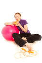 Woman with a slice of pizza, pink gymnastics ball Stock Photo